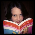 Miss 10 with Utterly Me, Clarice Bean - the book that inspired her to write.